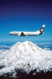 Watch the airplane flyig between mountains and descending very smoothly down to valleys.